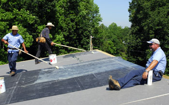 Max Made Sure The Rubber Didnu0027t Slide Off The Roof While Ovidio Applied  EPDM Bonding Adhesive To The Insulating Panels And Dario Rolled It Onto The  Back Of ...